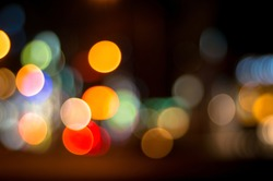 Unfocused, bokeh traffic and city lights at night