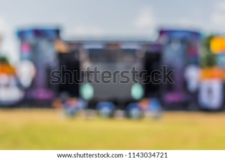 unfocused colorful blurred bokeh symmetry main stage facade in summer bright day time on one music festival