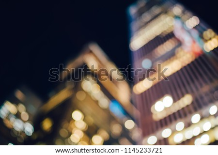 Unfocused evening view and bokeh of modern skyscrapers with headquarters and offices for rent in downtown, blurred background with modern corporate real estate and publicity area about business