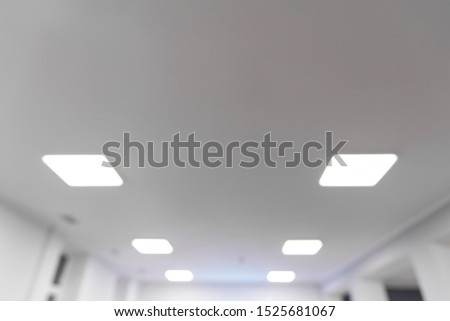 unfocused frame work office white interior roof lamps illumination empty copy space for your text