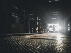 unfocused image of silhouette of the dark gym background with the sunlight  upon gym floor
