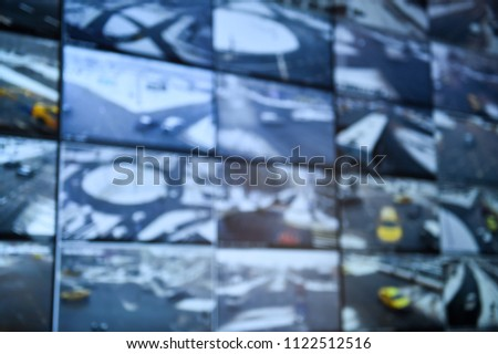 Unfocused image with security surveillance monitors command center #1122512516