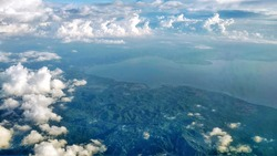 Unfocused Manado view from the airplane with cloud and beautiful sky