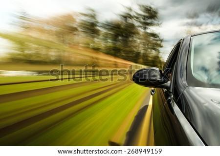 unfocused Mirror view of speeding car. #268949159