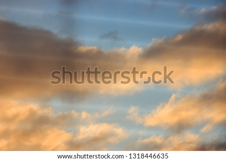 unfocused, multicolored clouds at dawn, view through the blinds. bright sky filled with sun, the morning of a new day. active awakening of the world #1318446635