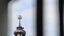 Unfocused, Noise, Blurry selective focus image. The roof of the mosque building with the logo of God or Allah on it, with the foreground blur. for background