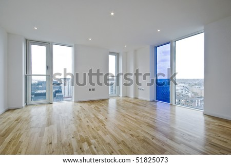 unfurnished dual aspect living room with laminate floor