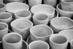 Unglazed pottery in an artist's workshop waiting to be processed