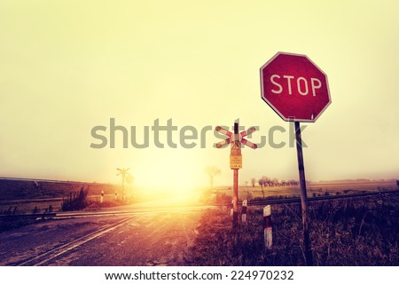 unguarded railway crossing in a ...