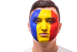 Unhappy and Failure of goal or lose game emotions of Romanian football fan in game supporting of Romania national team on grey background. European 2016 football fans concept.