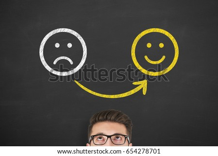 Unhappy and happy on chalkboard background #654278701