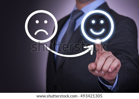 Unhappy and Happy Smileys on Touch Screen #493421305