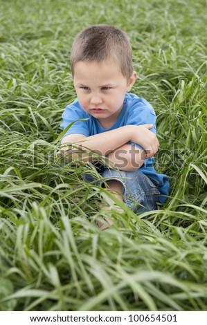 unhapPy boy in meadow