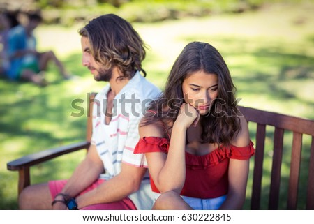 Unhappy couple ignoring each other in park