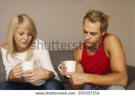 Unhappy couple on the lounge
