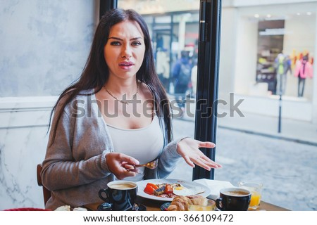 unhappy customer in restaurant, angry woman complaining about food and service in cafe