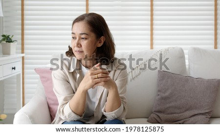Unhappy Female employee latin mom think sit sofa couch at home living room need help support panic coronavirus financial debt crisis in life insurance feel pain distress pensive regret lost upset.