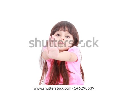 Unhappy girl saying stop with her hand