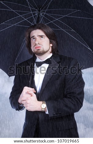 Unhappy Man in Suit Holding Umbrella in the Rain and Sighing
