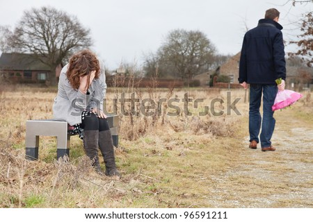 Unhappy man walking away from woman after a huge quarrel
