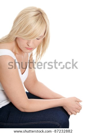 Unhappy mature woman in depression. Isolated on white background.