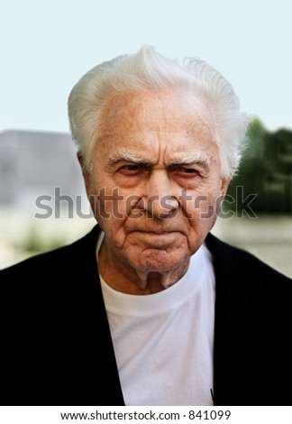 Unhappy old man frowning