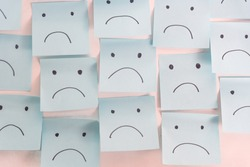 Unhappy Sad Emotion Face On Sticky Notes. Unhappy Employee Or Demotivated At working place.