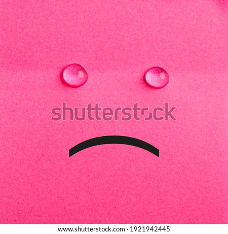 Unhappy sticky note. Pink paper. Tears. Hapless concept. Stockfoto ©
