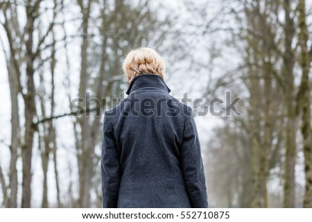 Unhappy woman having walk in winter