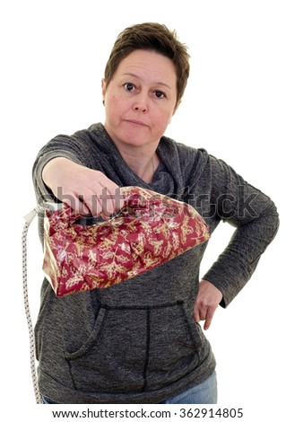 unhappy woman receiving an unwanted Christmas present in the shape of an iron. White background portrait with copy space.