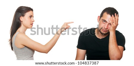 Unhappy young couple having an argument. Isolated on white.