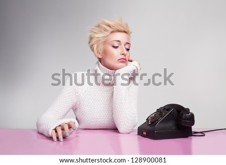 unhappy young girl waiting for phone ring despairingly