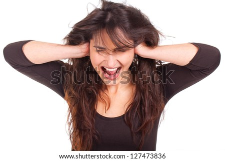 unhappy young woman covering her ears and screaming