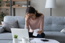 Unhappy young woman in glasses feeling stressed calculating monthly expenses at home, facing financial problems or lack of money for utility household or rental payments, bankruptcy concept.