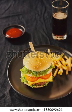 Unhealthy concept. unhealthy food: Burger, sauce, potatoes, cola. #1380092621