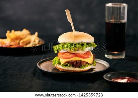 Unhealthy concept. unhealthy food: Burger, sauce, potatoes, cola.  #1425359723