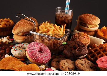 Unhealthy products. food bad for figure, skin, heart and teeth. Assortment of fast carbohydrates food with fries and cola Сток-фото ©