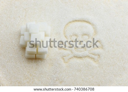 Unhealthy sweet food, obesity and diabetes mellitus concept : Top view of pure white refined, bleached sugar cubes / fine granulated sugar sweetener, skull and crossbones. Abstract texture background.
