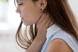 Unhealthy young woman touch neck hard to swallow having discomfort or painful feeling, unwell sad female employee suffering from angina or tonsillitis, sore throat, experience loss of voice