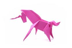 Unicorn : Origami pink unicorn. Isolated on white background.