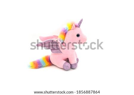 Unicorn plush toy. Isolated on white background  Stock photo ©