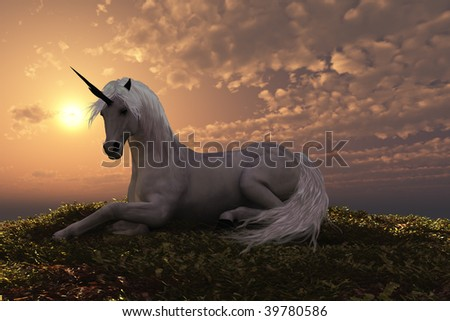 UNICORN - The fabled creature laying on a hilly knoll at sunset.