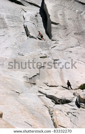unidentifiable female climber scaling a rock face at Yosemite