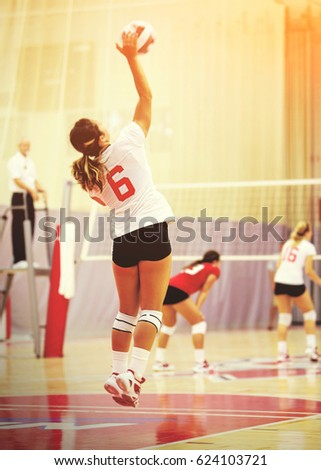 Unidentifiable woman volleyball player with rich matte toning