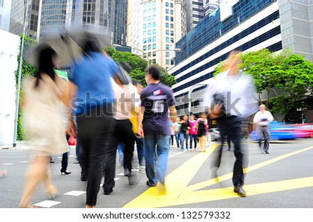 Unidentified businessmen crossing the street in Singapore. There are more than 7,000 multinational corporations from US States, Japan and Europe in Singapore