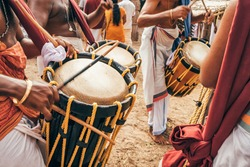 Unidentified Indian men play traditional percussion drum Chenda during temple festival in Kerala state, Southern India.