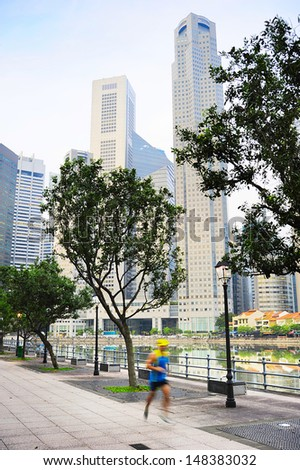 Unidentified men running on Singapore quayside in the morning