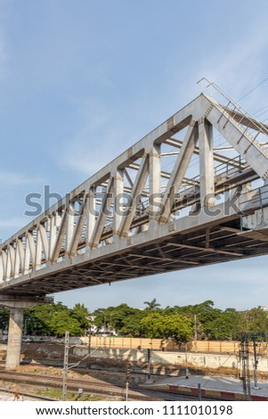Unidentified metro train iron bridge with zigzag lines built using modern day technology in India at an unidentified location #1111010198