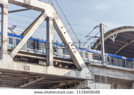 Unidentified metro train iron bridge with zigzag lines built using modern day technology in India #1118608688