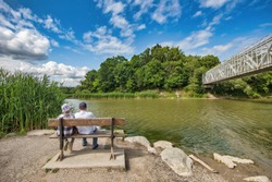 Unidentified people sitting and enjoying the Petticoat Creek conservation area at Pickering, Ontario, Canada